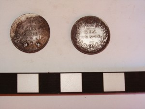 Back side of two sixpence's excavated at the mess hall at Sabi Bridge